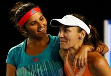 Switzerland's Martina Hingis (R) and India's Sania Mirza celebrate after winning their doubles final match at the Australian Open tennis tournament at Melbourne Park, Australia, January 29, 2016. REUTERS/Thomas Peter