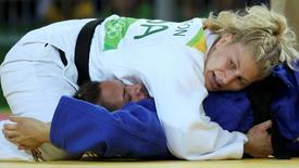 2016 Rio Olympics - Judo - Quarterfinal - Women -78 kg Quarterfinals - Carioca Arena 2 - Rio de Janeiro, Brazil - 11/08/2016. Kayla Harrison (USA) of USA and Abigel Joo (HUN) of Hungary compete. REUTERS/Toru Hanai