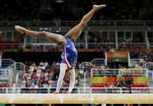 2016 Rio Olympics - Artistic Gymnastics - Final - Women's Individual All-Around Final - Rio Olympic Arena - Rio de Janeiro, Brazil - 11/08/2016. Simone Biles (USA) of USA competes on the beam during the women's individual all-around final. REUTERS/Damir Sagolj