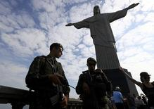 Brazilian security forces stand guard under the Christ the Redeemer statue in Rio de Janeiro, Brazil August 6, 2016. REUTERS/Leonhard Foeger
