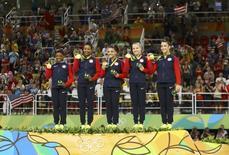 2016 Rio Olympics - Artistic Gymnastics - Final - Women's Team Final - Rio Olympic Arena - Rio de Janeiro, Brazil - 09/08/2016. (L-R) Simone Biles (USA) of USA, Gabrielle Douglas (USA) of USA (Gabby Douglas), Laurie Hernandez (USA) of USA, Madison Kocian (USA) of USA, Alexandra Raisman (USA) of USA (Aly Raisman) pose with their gold medals on the podium after winning the women's team final.   REUTERS/Mike Blake