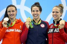 Gold medallist Maya DiRado of USA poses with silver medallist Katinka Hosszu of Hungary and bronze medallist Hilary Caldwell of Canada.    REUTERS/Dominic Ebenbichler