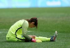 USA goalie Hope Solo reacts during their loss. REUTERS/Ueslei Marcelino