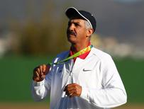 Aug 13, 2016; Rio de Janeiro, Brazil; Abdullah Alrashidi (IOA) on the podium after the men's skeet shooting gold medal match in the Rio 2016 Summer Olympic Games at Olympic Shooting Centre. Mandatory Credit: Guy Rhodes-USA TODAY Sports