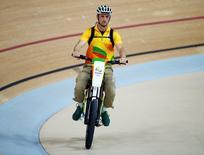 2016 Rio Olympics - Cycling Track - Preliminary - Women's Keirin First Round - Rio Olympic Velodrome - Rio de Janeiro, Brazil - 13/08/2016. Rio volunteer Ivo Siebert on the electric bike. REUTERS/Eric Gaillard