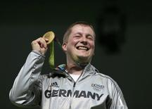 2016 Rio Olympics - Shooting - Victory Ceremony - Men's 25m Rapid Fire Pistol Victory Ceremony - Olympic Shooting Centre - Rio de Janeiro, Brazil - 13/08/2016. Christian Reitz (GER) of Germany poses with his gold medal.  REUTERS/Edgard Garrido