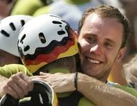 Germany's Stefan Henze (R) celebrates with teammate Marcus Becker after winning the silver medal in the men's canoe double competition at the Athens 2004 Olympic Games August 20, 2004. Henze died from head injuries sustained in a car crash in Rio de Janeiro, during the Rio 2016 Olympic Games. REUTERS/Reinhard Krause/Files