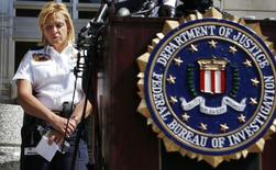 Metropolitan Police Chief Cathy Lanier pauses as she listens to Assistant Director in Charge of the FBI's Washington Field Office Valerie Parlave (not seen) host a news conference to share the findings about the investigation into the shootings at the Navy Yard last Monday at the FBI's Washington Field Office in Washington, September 25, 2013.    REUTERS/Larry Downing
