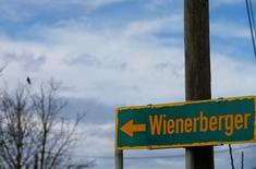 A road sign directs to the headquarters of Wienerberger, the world's biggest brick maker, in Hennersdorf, Austria, February 9, 2016. REUTERS/Heinz-Peter Bader - RTX28JVQ
