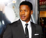 "Actor Nate Parker poses at the premiere of his film ""Non-Stop"" in Los Angeles February 24, 2014. REUTERS/Fred Prouser"