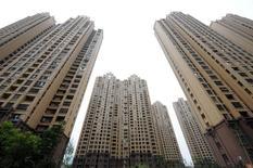 Les prix immobiliers dans les 70 plus grandes villes chinoises ont augmenté de 7,9% en juillet par rapport au même mois de 2015, selon des données officielles publiées jeudi. /Photo prise le 18 juillet 2016/REUTERS/China Daily