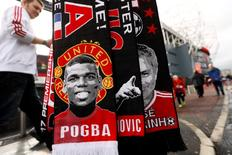 Football Soccer Britain - Manchester United v Southampton - Premier League - Old Trafford - 19/8/16 General view of a scarf featuring Manchester United's Paul Pogba outside the stadium before the match  Action Images via Reuters / Jason Cairnduff
