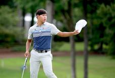 Aug 19, 2016; Greensboro, NC, USA; Si Woo Kim acknowledges the crowd on the ninth green after shooting a tournament record 60 during the second round of the 2016 Wyndham Championship. at Sedgefield Country Club. Mandatory Credit: Rob Kinnan-USA TODAY Sports
