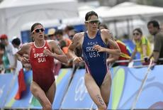 2016 Rio Olympics - Triathlon - Final - Women's Final - Fort Copacabana - Rio de Janeiro, Brazil - 20/08/2016. Gwen Jorgensen (USA) of USA and Nicola Spirig (SUI) of Switzerland compete. REUTERS/Jeff Pachoud/Pool