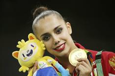 2016 Rio Olympics - Rhythmic Gymnastics - Victory Ceremony - Individual All-Around Victory Ceremony - Rio Olympic Arena - Rio de Janeiro, Brazil - 20/08/2016. Margarita Mamun (RUS) of Russia poses with her gold medal.  REUTERS/Matthew Childs