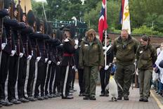 A king penguin named Sir Nils Olav inspects uniformed soldiers of His Majesty the King of Norway's Guard at RZSS Edinburgh Zoo, in Edinburgh, Scotland in this handout photograph from August 22, 2016.  RZSS/Katie Paton/Handout via REUTERS