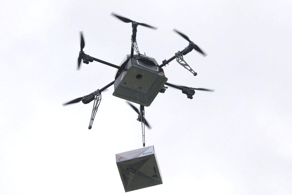 A Delivery Drone Performs Test Flight With Dominos Pizza Box In Auckland New Zealand August 25 2016 Handout Via REUTERS