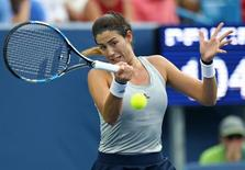 Aug 17, 2016; Mason, OH, USA; Garbine Muguruza (ESP) returns a shot against CoCo Vandeweghe (USA) on day five during the Western and Southern tennis tournament at Linder Family Tennis Center. Mandatory Credit: Aaron Doster-USA TODAY Sports