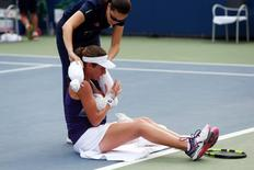 Aug 31, 2016; New York, NY, USA;  Johanna Konta of Great Britain receives medical attention during her match against Tsvetana Pironkova of Bulgaria on day three of the 2016 U.S. Open tennis tournament at USTA Billie Jean King National Tennis Center. Mandatory Credit: Jerry Lai-USA TODAY Sports