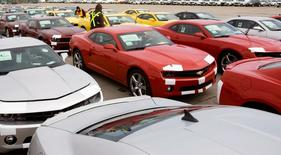 General Motors auto workers prepare rows of the new Chevrolet Camaro for delivery, at the company's Oshawa Ontario facility April 8, 2009. REUTERS/Fred Thornhill/File Photo