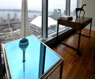 The CN Tower is reflected on an end table in the dining room of the Ritz Carlton residents model suite in Toronto, Ontario, Canada on May 1, 2012.  REUTERS/ Mike Cassese/File Photo