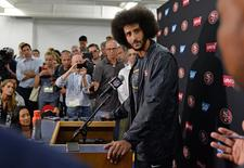 San Francisco 49ers quarterback Colin Kaepernick talks to media after the game against the San Diego Chargers at Qualcomm Stadium. Jake Roth-USA TODAY Sports