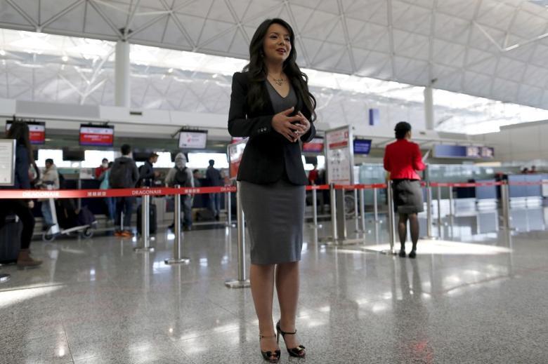 Miss World Canada Anastasia Lin poses for photo at the departure hall of Hong Kong Airport in Hong Kong, China November 27, 2015.  REUTERS/Tyrone Siu