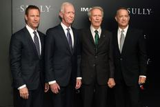 """Actor Aaron Eckhart (L), Captain Chesley 'Sully' Sullenberger (2nd L), director Clint Eastwood (2nd R), and actor Tom Hanks (R) attend the New York premiere of the film """"Sully"""" in Manhattan, New York, U.S., September 6, 2016. REUTERS/Darren Ornitz"""