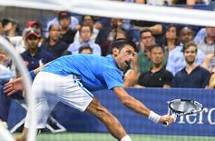 Novak Djokovic of Serbia hits to Jerzy Janowicz of Poland. Mandatory Credit: Robert Deutsch-USA TODAY Sports