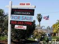 """A """"For Sale"""" sign is seen outside a home in Cardiff, California February 22, 2016.  REUTERS/Mike Blake"""