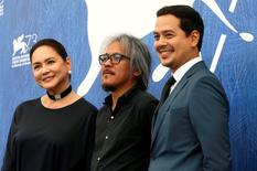 """Director Lav Diaz (C) poses with actress Charo Santos-Concio (L) and actor John Lloyd Cruz (R) as they attend the photo call for the movie """"Ang Babaeng Humayo"""" (The Woman Who Left) at the 73rd Venice Film Festival in Venice, Italy September 9, 2016. REUTERS/Alessandro Bianchi"""