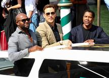 """Actors Denzel Washington (R) and Chris Pratt (C) leave by taxi boat for the film screening of """"The Magnificent Seven"""", at the 73rd Venice Film Festival in Venice, Italy September 10, 2016. REUTERS/Alessandro Bianchi"""
