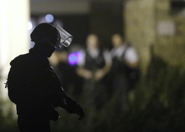 French policemen take part in a police raid in Boussy-Saint-Antoine near Paris, France, September 8, 2016. REUTERS/Christian Hartmann/Files