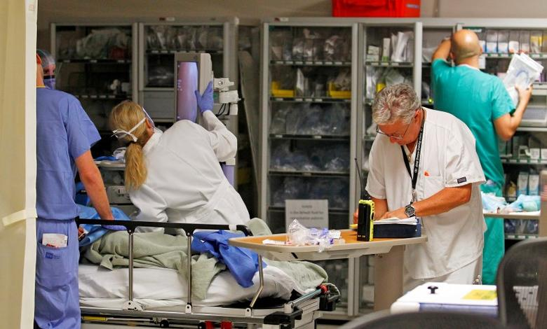Doctors and nurses work on a patient in the Ryder Trauma Center at Jackson Memorial Hospital in Miami, Florida  September 30, 2013. REUTERS/Joe Skipper