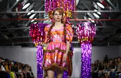 A model presents a creation at the Ryan Lo catwalk show during London Fashion Week Spring/Summer 2017 in London, Britain September 16, 2016. REUTERS/Neil Hall