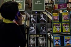 A woman looks at copies of 'Grey' in a bookstore in New York, U.S. on June 18, 2015.   REUTERS/Brendan McDermid/File Photo