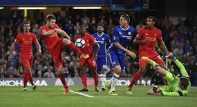Britain Football Soccer - Chelsea v Liverpool - Premier League - Stamford Bridge - 16/9/16 Liverpool's James Milner clears Reuters / Dylan Martinez Livepic
