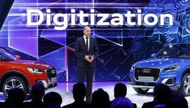 Stefan Knirsch, Member of the Board of Management for Technical Development of AUDI AG presents the new Audi Q2 car at the 86th International Motor Show in Geneva, Switzerland, March 1, 2016.   REUTERS/Denis Balibouse - RTS8P2J