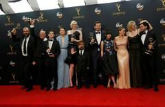 """The cast of HBO's  """"Game of Thrones"""" pose backstage with their award for Oustanding Drama Series at the 68th Primetime Emmy Awards in Los Angeles, California U.S., September 18, 2016.   REUTERS/Mario Anzuoni"""