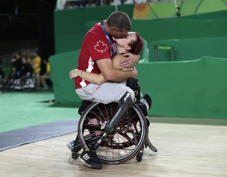 05d2d899f2e Canada s men s wheelchair basketball team player Adam Lancia embraces his  wife Jamey Jewells of Canada after