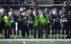 Sep 11, 2016; Seattle, WA, USA; Seattle Seahawks players and coaches interlock elbows during the playing of the national anthem during a NFL game against the Miami Dolphins at CenturyLink Field. Mandatory Credit: Kirby Lee-USA TODAY Sports