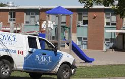 A Charlottetown Police vehicle drives into Sherwood Elementary School in Charlottetown, Prince Edward Island.  REUTERS/John Morris