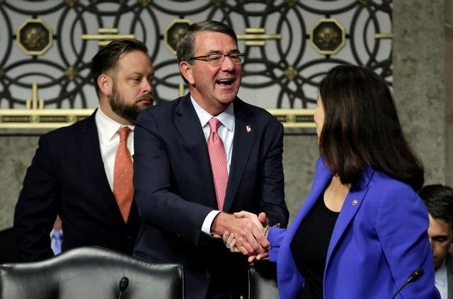 U.S. Defense Secretary Ash Carter shakes hands with Sen. Kelly Ayotte (R-NH) before a Senate Armed Services Committee hearing on National Security Challenges and Ongoing Military Operations on Capitol Hill in Washington, U.S., September 22, 2016. REUTERS/Yuri Gripas
