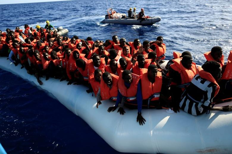An overcrowded dinghy with migrants from different African countries is escorted by members of the German NGO Jugend Rettet as they approach the Iuventa vessel during a rescue operation, off the Libyan coast in the Mediterranean Sea  September 21, 2016. REUTERS/Zohra Bensemra