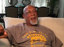 John Carlos, whose bronze medal at the 1968 Olympics was overshadowed by his raised-fist protest on the medal podium, speaks to a reporter in Gilroy, California, U.S. September 12, 2016.  REUTERS/Alan Devall