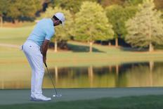 Sep 25, 2016; Atlanta, GA, USA; Rory McIlroy putts the fifteenth green on the third playoff round of the Tour Championship at East Lake Golf Club. Mandatory Credit: Brett Davis-USA TODAY Sports