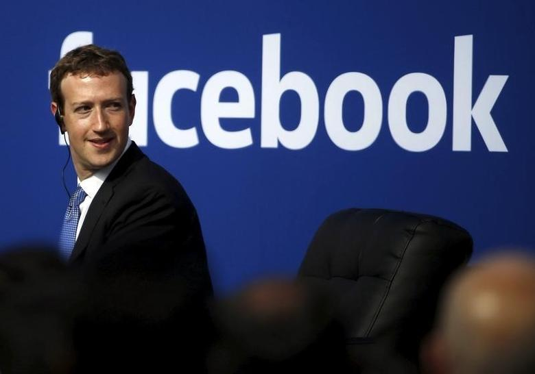 Facebook CEO Mark Zuckerberg is seen on stage during a town hall at Facebook's headquarters in Menlo Park, California September 27, 2015. Picture taken February 27, 2015.  REUTERS/Stephen Lam/File Photo - RTX2K5PB