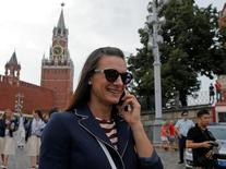 Russian track-and-field athlete Yelena Isinbayeva talks on her mobile phone as she walks at Red Square in Moscow, Russia July 27, 2016. REUTERS/Maxim Shemetov