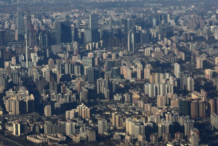 Apartments and buildings are pictured from a plane in central Beijing January 8, 2016.REUTERS/Kim Kyung-Hoon