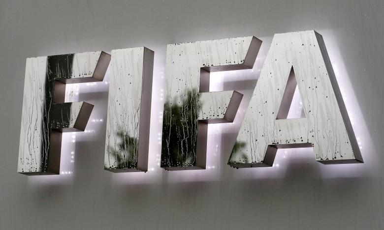 Raindrops flow down on a logo in front of FIFA's headquarters in Zurich, Switzerland June 8, 2016. REUTERS/Arnd Wiegmann